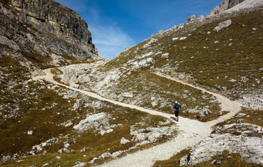 Uphill trail running man in Dolomites