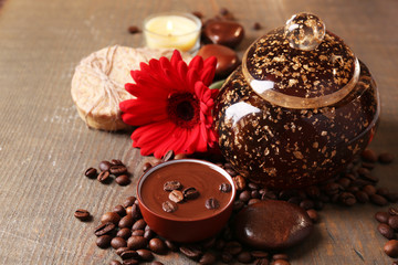 Composition of spa treatment, flowers and coffee beans