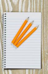 Pencils and paper on top of desktop