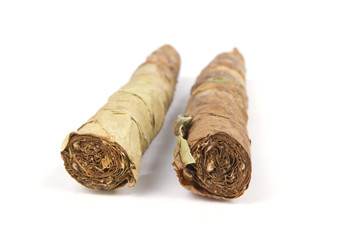 Handmade cigars on white with selective focus