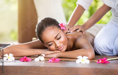 Smiling woman enjoying a massage © luckybusiness
