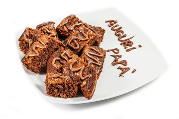 Chocolate brownies on white plate