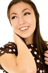 Smiling Asian American teen girl looking away arm up