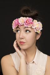 Beautiful brunette teen girl model wearing a floral crown