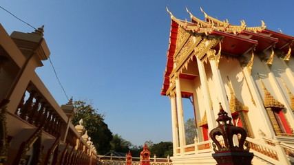 Public buddhist temple with blue sky in Thailand