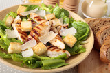 Caesar salad with griddled chicken and lettuce