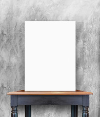 blank poster on vintage wooden table at concrete wall,Template f