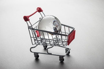 glass globe in the shopping trolley concept