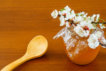 Honey in jar with wooden spoon