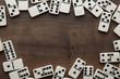 Leinwanddruck Bild - domino pieces on the wooden table background