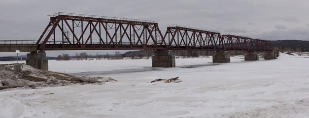 Railway bridge over the river, Siberia.