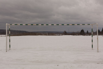 view from behind the gate on the football field, winter, Siberia