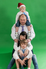 Portrait of the happy family with two children