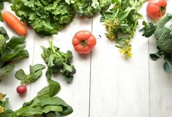 Fresh vegetables.frame.on white wooden background