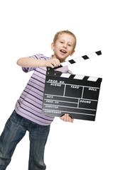 boy with clapperboard slanting