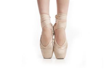 legs in pointe ballerina on white background