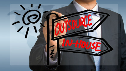 outsource or in-house signpost hand drawing by businessman
