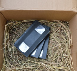 video recorder cassette on straw in the box