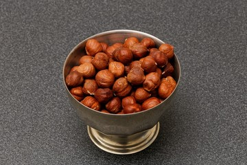 hazelnuts in metal bowl