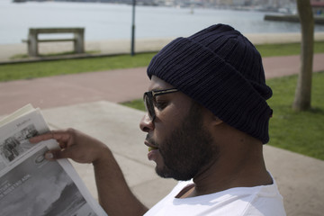 black man reading the newspaper