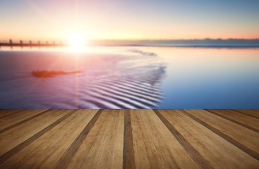Beautiful low tide beach vibrant sunrise with wooden planks floo