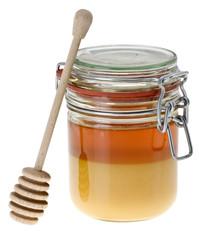 Glas Honig mit Honigheber