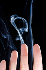 Smoking fingers on black background