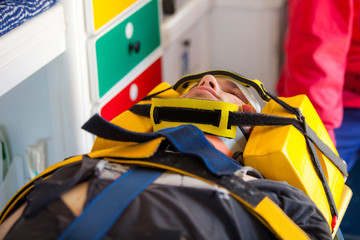 Injured man and an emergency worker inside an ambulance