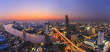 River in Bangkok city with high office building in night time