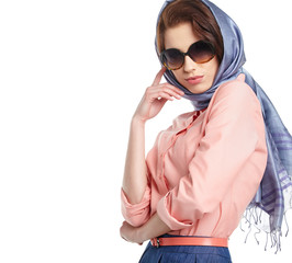 Fashion woman in sunglasses and scarf. studio shot