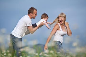 Family in a flowers field