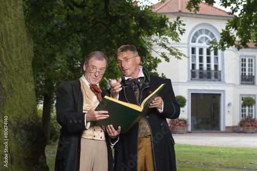 Plakat Die Brüder Grimm mit Märchenbuch