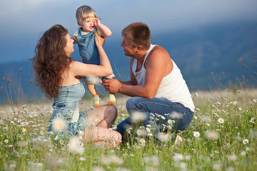 Happy family in flowers field