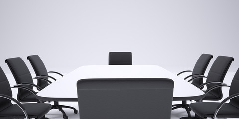 Conference table and black office chairs. Cropped image