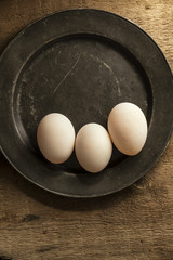 Fresh duck eggs in moody vintage retro style natural lighting se