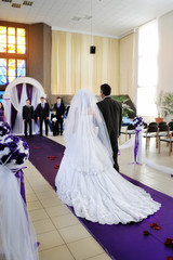 Happy father leads beautiful bride to the altar in the church