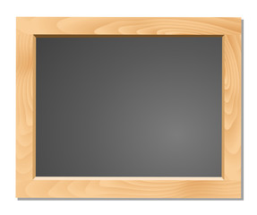 Wooden table on black chalkboard