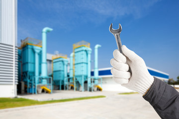 Factory maintenance working with wrench, Repairing heavy industr