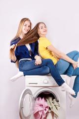 Two girls and a washing machine