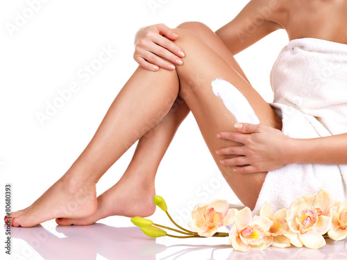 woman with a beautiful with flowers body using a cream