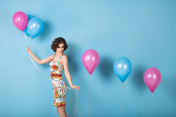 Girl with balloons in studio.