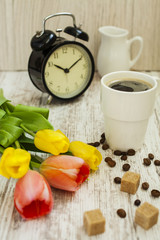 cup of coffee, tulips and hours