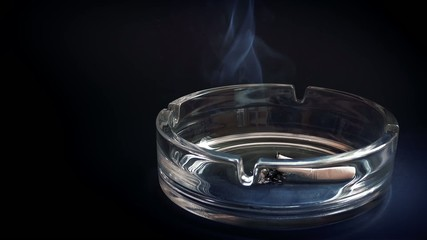 Cigarette Stubbed Out In Ashtray