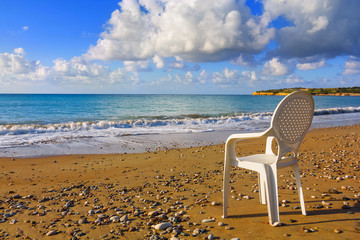 white armchair on a beach