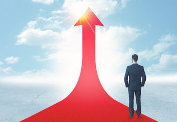 businessman standing on a red arrow