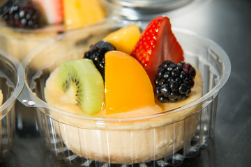 cheesecake decorated with fresh fruit