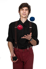 Young attractive male in a black shirt and red jeans with suspen