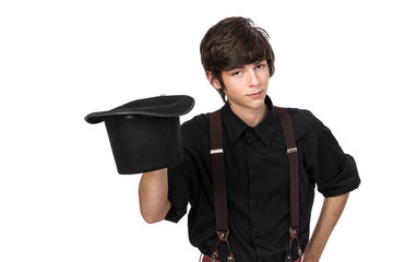 Young attractive male in a black shirt and jeans suspenders, hol