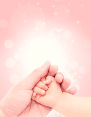 baby hand in hand of love with glitter background
