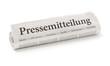 Zeitungsrolle mit der Überschrift Pressemitteilung - 80687729